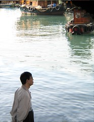 man in  Hong Kong (seligr) Tags: man water reflections boats person hongkong harbour contemplation