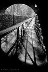 Light and shadow under the railway (Rory Prior) Tags: bridge light bw yorkshire tunnel railing calderdale fuji27mmf28
