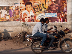 Hyderabad (Evgeni Zotov) Tags: street city people india cinema man bike movie poster star artist move indie actor catch biker hyderabad indi indien inde  hindistan andhrapradesh   ndia   telangana