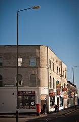 Street Corner (pixelhut) Tags: life street uk england people london corner cafe streetlight bluesky orbital shops postbox suburbs circular silvertown ringroad northwoolwich newham innerlondon london611