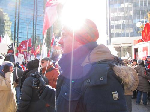 Male Rally Participant Holding Flag / Participant tenant un drapeau