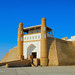 Beautiful sunny day view of ancient fortress - The Ark and the ceremonial entrance into it against the background of blue sky in Historic Center of Bukhara, Uzbekistan, Central Asia