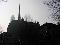 Wilibrord and the Domtoren (indigo_jones) Tags: winter horse sun mist holland tower church netherlands dutch statue architecture utrecht domtoren rooftops nederland spire kerk willibrord