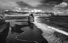 a coast of monolithic giants (lunaryuna) Tags: ocean sky bw seascape monochrome landscape coast blackwhite iceland solitude wake waves shoreline cliffs vik coastline lunaryuna cloudscape rockformations seastacks northatlantic southiceland arnardrangur capedyrholaey blackvolcanicbeach