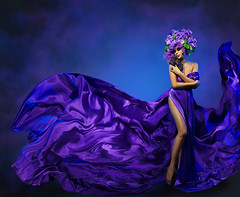Woman Flower Dress Flying Fabric, Beauty Fashion Model Dancing in Lilac Crown (noor.khan.alam) Tags: blue portrait people woman white flower sexy art floral girl beautiful beauty hat fashion lady female hair flying model glamour long perfume dress purple dancing wind background leg creative young silk violet posing style wave blowing latvia clothes lilac fabric fantasy fancy crown flowing gown cloth cosmetics waving fluttering cosmetic fashionmodel womanflower