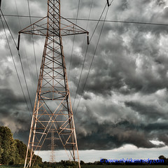 100 Days of Summer #17 - Power (elviskennedy) Tags: trees summer sky storm field lines rain station wisconsin clouds danger outside grey climb high power dynamic outdoor gray scenic elvis ground negative generator cumulus electricity change environment thunderstorm desaturated positive lightning polar storms range wi kennedy climate hdr highdynamicrange substation electrocuted globalwarming cumulonimbus neutral truss lineman electrode wwwelviskennedycom elviskennedy