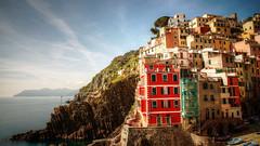 riomaggiore  cinque terre (mariusz kluzniak) Tags: sea italy cliff architecture coast europe village vivid terre colourful picturesque cinque riomaggiore