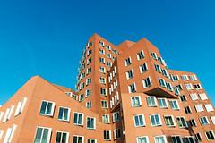 Neuer Zollhof buildings at MedienHafen, Dusseldorf (basair) Tags: blue architecture germany frank gehry nrw dsseldorf medienhafen neuer zollhof northrhinewestfalia