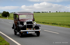 AN OLD BEAUTY IN KROPPENSTEDT (GERMANY, SAXONY ANHALT, KROPPENSTEDT) (KAROLOS TRIVIZAS) Tags: germany saxonyanhalt kroppenstedt car road asphalt antiquecar retro vintage field clouds treesdrivingcarrace poppies slope herb cultivation