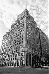 Cloudy Upper West Side (vpastro) Tags: street sky blackandwhite newyork building film monochrome clouds skyscraper vintage manhattan perspective upperwestside nikonfe orangefilter kodak400tx nikkor24mmf28ai