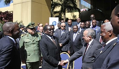 President Mugabe chats to AU Commissioner for Peace and Security Ambassador Ramtane Lamamra while incoming Cissa chairman Retired Major General Happyton Bonyongwe (left) and outgoing chairman General Rashid Lallali look on. (Pan-African News Wire File Photos) Tags: african intelligence meet chiefs harare in