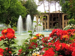 Spring colors by Isfahan palace fountain (Germn Vogel) Tags: red flower fountain spring asia iran jet middleeast palace isfahan qajar hashtbehesht islamicrepublic westasia gettyimagesmiddleeast