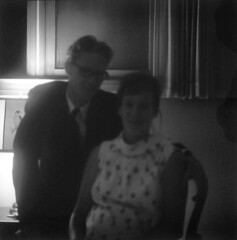 080466 07 (ndpa / s. lundeen, archivist) Tags: nick dewolf nickdewolf blackwhite photographbynickdewolf bw 1966 1960s film august unidentifiedlocation hosmer nd man woman brither sister siblings lucretia lucky lucretiahosmer luckyhosmer underexposed blurry dark 6x6 mediumformat monochrome blackandwhite blur