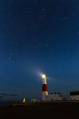 Light The Way To The Stars (www.paulshearsphotography.com) Tags: uk blue light red sea england sky lighthouse white seascape tower night photoshop canon buildings stars coast twilight unitedkingdom britain 5 beam clear adobe ii astrophotography dorset l nightsky usm f28 ef jurassic lightroom portlandbill lightbeam 1635mm portlandbilllighthouse adobelightroom cs5 portlad stralight starsinthesky revolvinglight canoneos5dmarkiii lighthousebeam eos5dmarkiii 5dmarkiii photoshopcs5 bemoflight lightroom5 paulshears paulshearsphotography wwwpaulshearsphotographycom adobelightroom5 revolvingbeam