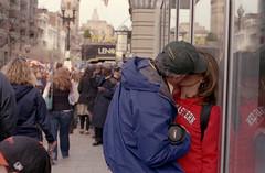 Kiss (dtanist) Tags: film boston analog 50mm kiss couple pentax massachusetts 400 intimate walgreens smc ricoh marathons pentaxm xrm