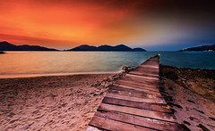 Semi darkness (Santo(Thanks for 2 Million++views!!)) Tags: longexposure light sunset sea sky beach water clouds evening bay jetty hills malaysia photographyforrecreationeliteclub