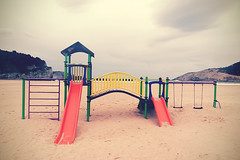 (Mimadeo) Tags: park sea sky beach colors childhood playground youth vintage children fun coast kid sand colorful child play outdoor empty nobody retro nostalgia filter coastline leisure recreation colourful melancholy effect playful melancholia instagram