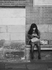 Little woman. (Bart) Tags: street blackandwhite bw white black cute monochrome lost photography blackwhite thought noir candid strangers streetphotography olympus stranger nb micro charming f18 rue blanc lostinthought 43 noirblanc 75mm photoderue m43 mft ep5 micro43 microfourthirds microfourthird 43 75mm18 mzuiko mzuikodigital olympusep5 olympus75mmf18 mzuikodigitaled75mmf18