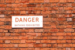 Bathing? In the Chesterfield Canal? (Squatbetty) Tags: red brick sign wall danger nottinghamshire redbrick worksop chesterfieldcanal worksoptownlock