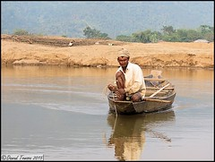 Fishing, Bisnakandi (dark-dawud) Tags: poverty trees man reflections river asian boat fishing sand scenery asia poor culture woodenboat fishingboat sylhet bangladesh sandbank fishingvessel manfishing indianborder bangladeshborder bisnakandi