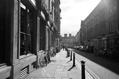 Oxford (Jim Davies) Tags: uk blackandwhite bw film monochrome 35mm photography streetphotography olympus oxford boingboing analogue mjuii oxfordshire citycentre stylusepic compactcamera c41 chromogenic kingedwardstreet veebotique filmfilmforever