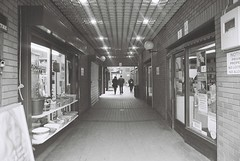 Shops (goodfella2459) Tags: people white black film analog 35mm lens nikon super xp2 400 shops 24mm af nikkor stores milf ilford f4 wolverhampton c41 f28d