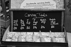 Carving Tool Box (Man with Red Eyes) Tags: nature monochrome digital blackwhite nikon conversion display zoom box carving d500 18105 accumulation bushcraft nikond500 afsdxnikkor35mmf18g toolsknives bushcraftshow capturenxd