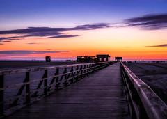 afterglow (2) (claudia.kiel) Tags: bridge sunset twilight sonnenuntergang northsea dmmerung nordsee afterglow stpeterording seebrcke olympusem10