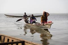 Refugees on Lake Chad (jeromestarkey) Tags: africa reflection water children dawn fishing women child fishermen chad refugee refugees transport paddle calm canoe haram dugout unhcr afrique tchad boko lakechad livelihood lactchad bagasola