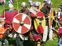 Fighting the big 'uns! (crapatdarts) Tags: grass training children outdoors helmet warriors nationaltrust shields corfecastle saxons crapatdarts