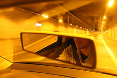 his reflection (Renia(69)) Tags: car driving night athens yellow light tunnel lights city canon photography nophotoshop spring face human man people mirror road colored outdoor urban shirt seatbelt life moments hidden lips neck youth adult flickr 2016 may
