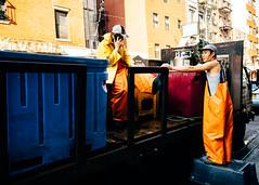 Orange Rain Bibs (Dalliance with Light (Andy Farmer)) Tags: street nyc portrait orange newyork truck us chinatown unitedstates manhattan fishmongers bibs rainbibs