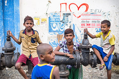 Boys hanging out in Kolkata (phil.w) Tags: street friends india playing love boys kids hydrant graffiti colorful pentax market brothers tofu worn posters hanging limited kolkata calcutta hogg smcpfa31mmf18