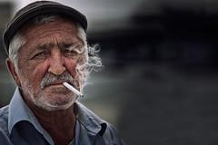 smoke (aglotix) Tags: old boy portrait white man black turkey bokeh smoke trkiye oldman istanbul smoking human portre