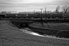 run to the river (fallsroad) Tags: railroad blackandwhite bw water train industrial oil refinery arkansasriver tulsaoklahoma nikond7000