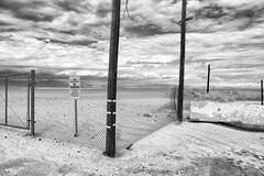 No Trespassing (autobahn66.com) Tags: california blackandwhite abandoned landscape desert cloudy dramatic surreal saltonsea