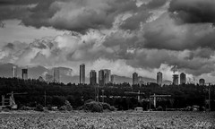 City transformation  (T.ye) Tags: city urban blackandwhite cloud mountain canada vancouver contrast skyscraper landscape outside countryside crane centre columbia richmond burnaby british todd   ye ourdoor