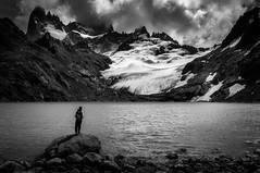 Admiring Laguna de los Tres - BW (hzeta) Tags: laguna de los tres el chalten argentina patagonia lake lago water agua mountain montaa galciar glacier ice hielo fitz roy peak pico clouds nubes solitude soledad one person only solo una persona solitario staring admirando disfrutando enjoying black white blanco y negro bw bn