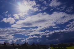 Breakthrough (Alan FEO2) Tags: blue houses sky urban sun rain clouds buildings landscape outdoors horizon panasonic stokeontrent g1 dmc 2oef