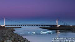Icebergs Escaping (Michael C. Jensen) Tags: bridge sunset iceland glacier atlanticocean icebergs midnightsun jokulsarlonlagoon vatnajkullglacier floatingicebergs