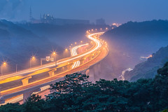 Doubled Freeways  (Sharleen Chao) Tags: longexposure color horizontal fog night canon mood cityscape freeway bluehour hazy curve tone starburst 70200mm  lighttracks linko   canoneos5dmarkiii canon5dmarkiii newtaipeicity  carlightstracks