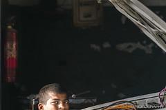 Working Childhood !!` (GoCiP) Tags: street pakistan portrait people car canon photography kid candid streetphotography photojournalism portraiture mechanic lahore youngguy 450d canon450d gocinematic gocip zeeshangondal