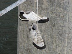 Shoes hanging from bridge cable (SchuminWeb) Tags: bridge white robert river concrete foot shoe james virginia march memorial shoes ben footbridge lace district steel web bridges pedestrian cable structure richmond sneakers tennis cables va lee e infrastructure belle unlimited isle infra structural laces rva unltd ecko shoelaces robertelee 2013 infrastructural roberteleememorialbridge schumin schuminweb