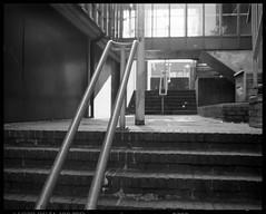 way up (ha*voc) Tags: bw 120 film haarlem stairs mediumformat urbandecay rangefinder 6x7 expired ilforddelta400 xtol 80mm mamiya7ii urbanstilllife epsonv750