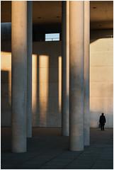Dwarfed & Stonewalled (frischauge) Tags: light shadow woman sun building architecture golden fuji magic pillar x hour fujifilm 1855mm xf xe1 wsarchitecture