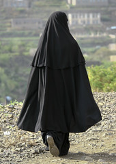 Veiled Woman Walking, Ibb, Yemen (Eric Lafforgue Photography) Tags: people woman vertical outside person asia day alone adult outdoor fulllength middleeast arabia daytime yemen masked niqab ibb oneperson masque onepeople colorphoto fullback dayview burka realpeople colorpicture placeofinterest nikab arabiafelix arabianpeninsula 1people colourpicture blissfularabia
