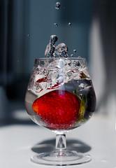 Splash (svetlanatsoy) Tags: light red water glass 50mm drops strawberry berry bokeh wineglass splash nikkor50mm d5100 nikond5100