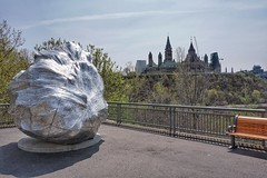 What is this doing here? Public art in Ottawa. (beyondhue) Tags: street sculpture ontario tower art public silver river bench this is spring gallery peace path name ottawa hill parliament canadian here doing national what beyondhue