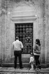 Parents praying, little girl playing (Mustafa Selcuk) Tags: street blackandwhite bw monochrome turkey muslim islam praying streetphotography monochromatic istanbul fujifilm sb bnw siyahbeyaz xpro2