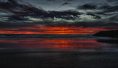 The Burning Sky Of Venice (Wilkof Photography) Tags: ocean california ca winter light sunset shadow sea sky seagulls seascape reflection beach nature wet water overgrown birds silhouette skyline night canon dark lens landscape outside golden evening coast countryside boat seaside sand rocks surf waves waterfront sundown cloudy yacht dusk horizon perspective scenic rocky surreal windy overcast panoramic boulder symmetry pacificocean socal land coastline venicebeach serene redsky lowtide southerncalifornia sailorsdelight polarizer picturesque cloudcover beachfront cpl 18mm rockformation oceanfront oceanscape 18135mm canont4i wilkofphotography